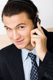 Young businessman holding a mobile phone Stock Image