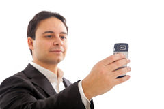 YOUNG BUSINESSMAN HOLDING MOBILE PHONE Royalty Free Stock Image