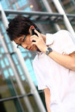 Young businessman holding mobile phone Stock Photography