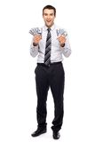 Young businessman holding money Stock Photo