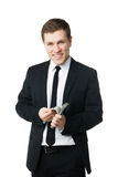 Young businessman holding money Royalty Free Stock Photo