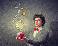 Young businessman holding moneybox. Image of young businessman in red glasses holding moneybox Stock Photography