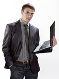 Young Businessman holding notebook computer Stock Photo