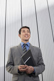 Young Businessman Holding Notebook Royalty Free Stock Images