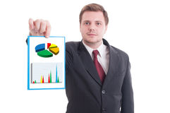 Young businessman holding paper with investment growth. Young businessman or manager holding paper with chart and graph representing investment growth Royalty Free Stock Image
