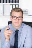 Young businessman is holding a pen in his hand Royalty Free Stock Photo