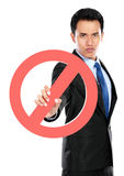 Young businessman holding prohibited sign Stock Images
