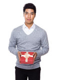Young businessman holding with red gift box Royalty Free Stock Images