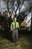 Young Businessman Holding Shovel Stock Image