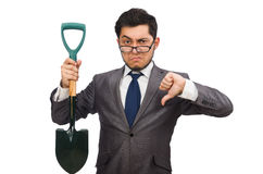 Young businessman holding a spade isolated on Royalty Free Stock Photos