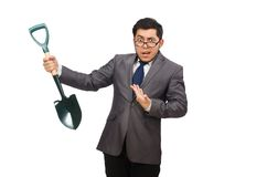 Young businessman holding a spade isolated on the Royalty Free Stock Photo