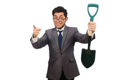 Young businessman holding a spade isolated on the Stock Image