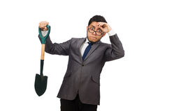 Young businessman holding a spade isolated on Stock Photography