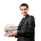 Young businessman holding stack of books Stock Images