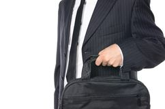 Young businessman holding suitcase. Isolated on white Stock Photos