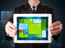 Businessman holding a tablet with modern software operational sy Stock Image