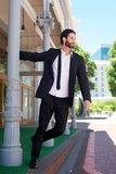 Young businessman holding on to a pole outside Royalty Free Stock Photography