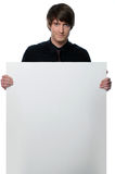 Young businessman holding a white board Royalty Free Stock Photography