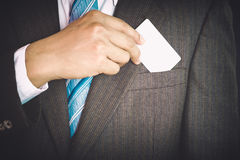 Young businessman holding white business card Royalty Free Stock Image