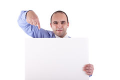 Young businessman holding a whiteboard  pointing Royalty Free Stock Photo