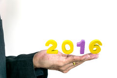 Young businessman holding words Happy New Year. Young businessman holding a words greeting Happy New Year stock photography