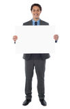 Young businessman holds the blank billboard Stock Image