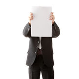Young businessman holds blank signs. Stock Photos