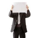 Young businessman holds blank signs. Royalty Free Stock Images