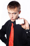 Young  businessman holds an empty business card Royalty Free Stock Photography