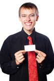 Young  businessman holds an empty business card Royalty Free Stock Image