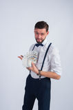 Young businessman holds a fan of dollars stock photo