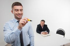 Young businessman holds marker writing, drawing Stock Photo