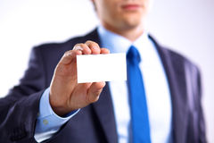 Young businessman holds out his hand with a business card Royalty Free Stock Photography