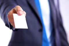 Young businessman holds out his hand with a business card Royalty Free Stock Image