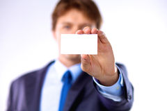 Young businessman holds out his hand with a business card for love Royalty Free Stock Images