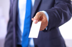 Young businessman holds out his hand with a business card for love Royalty Free Stock Image