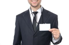 Young businessman with identification card. Isolated Stock Photography
