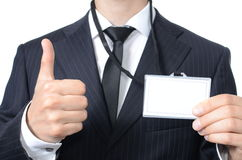Young businessman with identification card. Isolated Stock Photo