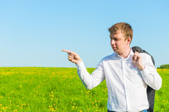 Young businessman indicates the side Royalty Free Stock Image