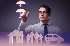 The young businessman in insurance concept Stock Photo