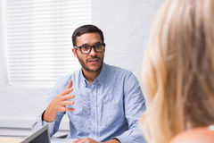 Young businessman interviewing woman Royalty Free Stock Images
