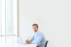 Young businessman isolated in office Stock Photo