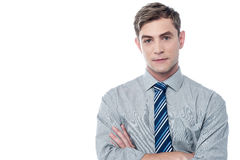 Young businessman isolated on white. Confident businessman posing with crossed arms Royalty Free Stock Photography