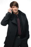 Young businessman in jacket  using a mobile phone Stock Photography
