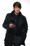 Young businessman in jacket  using a mobile phone Royalty Free Stock Photos