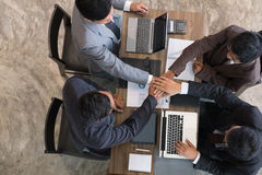 Young businessman joining hand, business team touching hands tog. Young asian businessman joining united hand, business team touching hands together after Royalty Free Stock Image