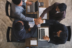 Young businessman joining hand, business team touching hands tog Stock Photography