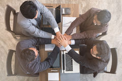 Young businessman joining hand, business team touching hands tog. Young asian businessman joining united hand, business team touching hands together after Stock Images