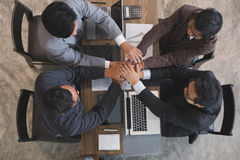 Young businessman joining hand, business team touching hands tog. Young asian businessman joining united hand, business team touching hands together after Royalty Free Stock Photo