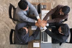 Young businessman joining hand, business team touching hands tog. Young asian businessman joining united hand, business team touching hands together after Stock Photo